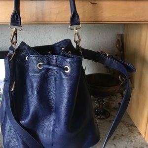 Cobalt Blue bucket purse with side zippers.